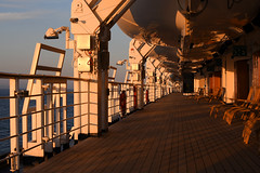 Bon Voyage! (Anthony Mark Images) Tags: mseurodam hollandamericaline cruiseship alaska musterdeck ship ocean water evening shadows deck lifeboats woodenloungechairs sailing