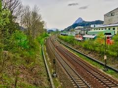 Railway tracks in Kiefersfelden, Bavaria (UweBKK (α 77 on )) Tags: railway rail tracks spring trees trains pendling mountain alps kiefersfelden bavaria bayern germany deutschland europe europa iphone