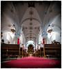 A ras del suelo (marianobs) Tags: iglesia perspectiva colores contraste bancos altar andalucia 1424mm nikon albombra rojo