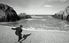 Skimming stones at Barricane (PetePhoto61) Tags: woolacombe devon barricane stones skimming boy koda trix nikon f3 nikonf3 hc110 nike