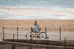 Meet you by the crossing (PhredKH) Tags: 100mm bicycles canoneos7dmkii canonphotography coastalbritain coastaltown ef70200mmf28lisiiusm fredkh onthestreet peopleonthestreet photosbyphredkh phredkh splendid streetphotography worthing bikes fence pedestriancrossing pedestrians people peoplewatching road street beech water seaside beach sea