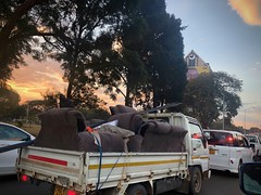 Harare Traffic (The Advocacy Project) Tags: road highway traffic couch pickuptruck sunset light africa zimbabwe harare cars