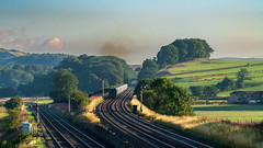 Going away (Mark Gowing) Tags: settle settlejunction semaphores semaphoresignals railwayjunction junction 66761 class66