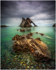 Dead Calm (Augmented Reality Images (Getty Contributor)) Tags: nisifilters benro bowfiddlerock calm canon cliffs clouds landscape morayfirth nature portknockie rocks scotland seascape water