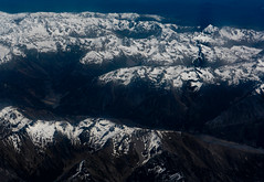 The Mountain of the Forgotten King (Steve Taylor (Photography)) Tags: mountain skull range black blue contrast stark white newzealand nz southisland canterbury southernalps alps snow view aerial