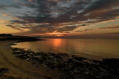 Sunrise (richardsolway) Tags: sunrise sun rise beach sea waves ocean golden clouds landscape coast sand rocks coastal orange