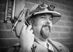 Portrait from the Whitby Steampunk Weekend IV - Days Like These (Gordon.A) Tags: yorkshire whitby steampunk whitbysteampunkweekend iv dayslikethese wsw july 2018 convivial creative costume goggles culture lifestyle style fashion man people street festival event eventphotography outdoor outdoors outside wall amateur streetphotography pose posed portrait streetportrait blackandwhite bnw bw mono monochrome monochromatic naturallight naturallightportrait digital canon eos 750d sigma sigma50100mmf18dc