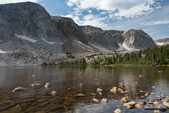 Rocks in Lake Marie (kevin-palmer) Tags: snowyrange medicinebownationalforest wyoming mountains summer july afternoon nikond750 tamron2470mmf28 water lakemarie clouds boulders rocks