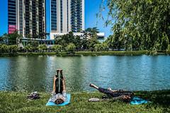 Stretching in the park (Melissa Maples) Tags: batumi batum ბათუმი adjara აჭარა georgia gürcistan sakartvelo საქართველო asia 土耳其 apple iphone iphonex cameraphone spring pond water georgian woman man couple park grass yoga pilates stretching 6მაისისპარკი 6maypark