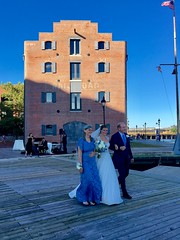 processing in the magic hour (karma (Karen)) Tags: baltimore maryland fellspoint frimmaritimepark weddings procession family walls windows hww cmwd