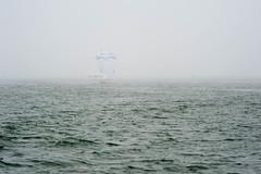 Nessie Emerges from the Fog (JBAdams) Tags: sailboat sail sailing yacht regatta fog mya merriconeagyachtingassociation sea ocean boat water maine harpswell manualfocus availablelight nikond700 digital nikkor18028ed spinnaker flyingscot