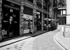 Jun 20, 2018 (pavelkhurlapov) Tags: shade gate building corner cityscape streetphotography monochrome advertisement girl people men curve curb geometry bar road sign column