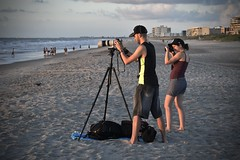 Shooting the Sunrise (tim.perdue) Tags: florida vacation 2018 summer orlando seaworld cocoa beach people figures man woman photographer camera tripod sunrise morning dawn sand ocean sea surf waves coast shore atlantic water sky clouds candid street shooting