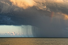 Rain Cloud (Geoff Henson) Tags: cloud rain storm sky sea water blue grey windfarm windmills wet weather