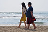 In synch (Roving I) Tags: asian tourists couples instep insynch contrasts barefeet beaches whitesand sea surf walking waves sneakers smartphones danang vacations vietnam leisure lifestyle holidays