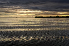 Bring Us The Water In Golden Waves (Alfred Grupstra) Tags: nature sunset water sky landscape reflection dusk outdoors sea scenics beach cloudsky summer beautyinnature lake tranquilscene nopeople blue sunlight cloudscape snekermeer waves