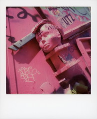 Pink Head (tobysx70) Tags: polaroid originals color sx70 instant film camera pink head clarion alley street mission district san francisco california ca face graffiti urban art tag sculpture polawalk polavacation 042718 toby hancock photography
