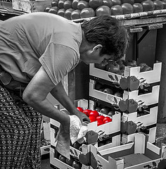 Picking the ripe ones (Leaning Ladder) Tags: belgrade beograd serbia market blackandwhite bw selectivecolor colorsplash red leaningladder