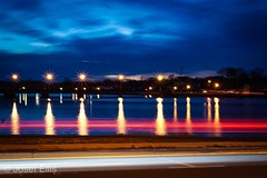 Water and Lights (joeellispercussion) Tags: sunset clouds lights water lighttrails longexposure 50mm sonya6000 sony