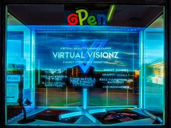 Virtual Visionz (Steve Taylor (Photography)) Tags: push open virtualreality gaminglounge virtualvisionz 5hardystreet newbrighton hearttransplant shootzombies graffitilegally bathurst andmuchmore projector art digital picture sign shop window blue glass newzealand nz southisland canterbury christchurch ventitienblind