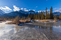 Three Sisters from a frozen Policemen's Creek in winter, Canada (tvrdypavel) Tags: alberta banff bow bubbles canada canmore country creek day frozen ice kananaskis mountains national park policemen provincial reflection river rocky s sisters snow sunset three winter