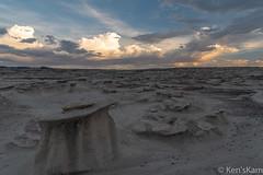 Natural Modification (Ken'sKam) Tags: rain rocks clouds cloudy storm nature geology newmexico desert hoodoos naturesartwork bistibadlands bisti sky sunset