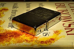 """""""What matters most is how well you walk through the fire"""" (Ivan Herrador) Tags: red zippo lighter charlesbukowski poet poetry book yellow dirtyrealism losangeles underground burninginwaterdrowninginflame micronikkor60mmf28 nikkor nikond3s macro poem"""