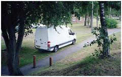White Van (peterphotographic) Tags: img024edwm whitevan olympus xa2 ©peterhall oxford oxfordshire england uk britain porta porta160 35mm film analog scanned filmcompact van car truck parked tree path pavement urban