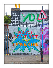 Street Art (Unknown), East London, England. (Joseph O'Malley64) Tags: unknownartist graffiti graffitiartist eastlondon eastend london england uk britain british greatbritain donaldtrump trump presidenttrump tangerine orange lunatic ignorant ignorance rageagainstthetangerine rageagainstthemachine ratm wall walls brickwork bricksmortar cement pointing roadnarrowsonrightsign sign signage breezeblocks breezeblockinfill signpost concrete steelfencing securityspikes drainpipe workshops londonplanetree carpark urban urbanlandscape aerosol cans spray paint accuracyprecision