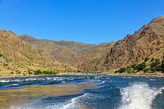 Leaving The Rapids On Hells Canyon (http://fineartamerica.com/profiles/robert-bales.ht) Tags: fahellscanyon facebook forupload haybales hellscanyontrip idaho people photo photouploads places projects states nature canyon landscape recreation river wilderness area remote mountain america usa wild white hell oregon green range vacation scene outdoors scenic hells hiking tourism water salmon blue snake desert eastern fishing fly outdoor riggins rock rugged nez trout beauty steelhead conservation clouds devils tourist united gorge mountains washington snakeriver hellscanyon robertbales boat jetboat rapids mixedmedia