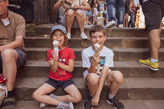 ellie and dan on step with ice cream (iamthecandleman) Tags: e iphone 70 24 digital a7r sony bottle hat tshirt red depth background forground smile portrait look train niece girl people nephew