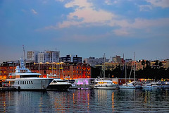 Port De La Barceloneta - nightfall (Fnikos) Tags: port porto puerto harbour harbor sea water mar mare sky cloud skyline city building architecture tower ship boat sailboat waterfront night nightview nightfall nature people evening outdoor