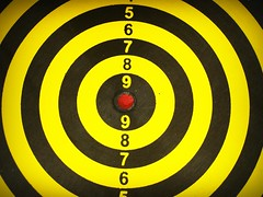 Dartboard target aim goal achievement concept (www.icon0.com) Tags: target goal aiming dartboard aim focus arrow s skill closeup dart achievement shot success bullseye one black precise achieve accuracy luck strategy hit winner center selective competition throw bull hipster score board successful winning victory sisal single perfect point game eye perfection
