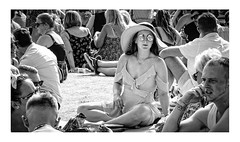 Mirrored shades (Photography And All That) Tags: girl hat sunglasses mirrored shades people crowd sitting seated festival summer blackwhite blackandwhite monochrome monochromatic monochromes whitephotoborder photoborder vignette outdoors outdoor outside relaxed face faces streetphotography street sony sonyalpha7mark3 sonyilce7m3 sonyalpha ilce7m3 portrait expression portraits expressions smile enigmatic park picnic sunhat