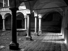 Dim light (Guido Colombini) Tags: historicalhouses pillars pit bianconero courtyard valtellina bw teglio dimlight manor architechture