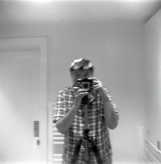 reflected self-portrait with Kodak Brownie Cresta II camera and cap (pho-Tony) Tags: cameraselfportraits fujiacros kodakbrowniecrestaii kodak brownie bakelite plastic 120 6x6 mediumformat 6cmx6cm rollfilm kodet cheap massmarket hobby 1950s blackandwhitenegative film rodinal home developing diy black white blackandwhite ishootfilm filmisnotdead fuji acros iso 100 fujiacrosiso100