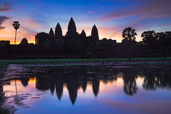 Angkor Wat at dusk with reflecting in water, Siem Reap Cambodia (Patrick Foto ;)) Tags: ancient angkor archeology architecture asia asian buddha buddhism building cambodia cambodian colorful culture dusk exterior heritage hinduism indochina jungle khmer lake landmark monument old palm reap reflection religion religious ruin siem site sky stone sunrise sunset temple thom tomb tourism tower travel tree tropical twilight unesco wat water world worship krongsiemreap siemreapprovince kh
