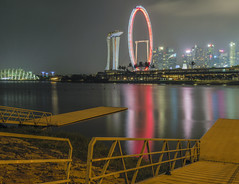 the Flyer and bay (vnrnaveen) Tags: red cityscape singapore bay longexposure landscape night nightphotography lights gardens marina asia