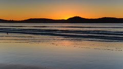 Orange Glow Sunrise Seascape and Mountain Silhouettes (Merrillie) Tags: daybreak sunrise nature dawn uminabeach centralcoast morning sea landscape newsouthwales rocks earlymorning nsw clouds beach ocean water uminapoint waterscape coastal cloudy sky seascape australia coast outdoors waves
