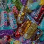 Closeup of glittery shimmery shiny pills capsule background thumbnail