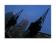 Old meets New (Paul Weller Photography) Tags: canarywharf docklands london crane night tower hirise building westindiaquay banking finance steel glass