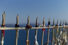 Fence (•Nicolas•) Tags: color couleur fence greece holidays m9 vacances santorini sky ciel sea mer barrière nicolasthomas lock cadenas rust rouille ribbons rubans