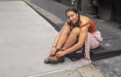 A Young Woman Who Stopped to Tie Her Shoe (J MERMEL) Tags: girl shoes boots unlaced nyc