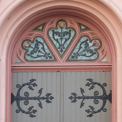 A16555 / saint boniface entry (janeland) Tags: sanfrancisco california 94102 tenderloin january 2018 goldengateavenue architecturaldetail doors entry leadedglass pinkandblue ironwork saintboniface catholic church franciscan square cropped arch