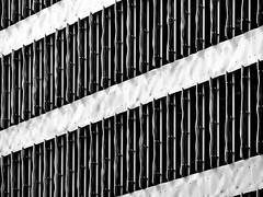 heat shilds (heinzkren) Tags: pattern muster lamellen sonnenchutz fassade facade building gebäude scharzweis blackandwhite bw sw monochrome lumix modern contemporary fenster windows structure struktur architektur architecture symmetry paneel paneling lines texture shadow light jalousie lichtschutz protector schutz abstract linien hypo konzernzentrale stpölten panasonic geometry panele