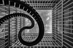 Endless Staircase (Leipzig_trifft_Wien) Tags: münchen bayern deutschland de art sculpture architecture black white bnw bw blackandwhite monochrome modern contemporary building steelstructure stairs lookup lookingup sky facade lines glass mirror city urban