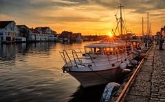 Haugesund, Norway (Vest der ute) Tags: norway rogaland haugesund seaside water sea city xt2 summer evening houses quay boat sailboat sky clouds sunset cobblestone tire sunstar building fav25 fav200