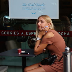 Cookies (Luxifurus) Tags: hip hipshot fromthehip candid unposed covert unaware secret stolen gimp commute london street portrait urban woman girl female pretty beautiful hands faces