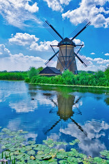 Windmill in Kinderdijk, Netherlands (Jochem.Herremans) Tags: windmill dutch netherlands landscape summer kinderdijk water countryside holland windmills sky rotterdam green old scenery nature environment river rural history wind isolated europe famous heritage mill traditional background retro travel architecture village european building reflection culture agriculture landmark scenic beautiful colorful