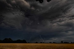 Heatwave ends. (bainebiker) Tags: storm lightning clouds sky wheat field trees menacing forboding canonef24mmf14liiusm longexposure landscape ominousclouds langtoft lincolnshire uk